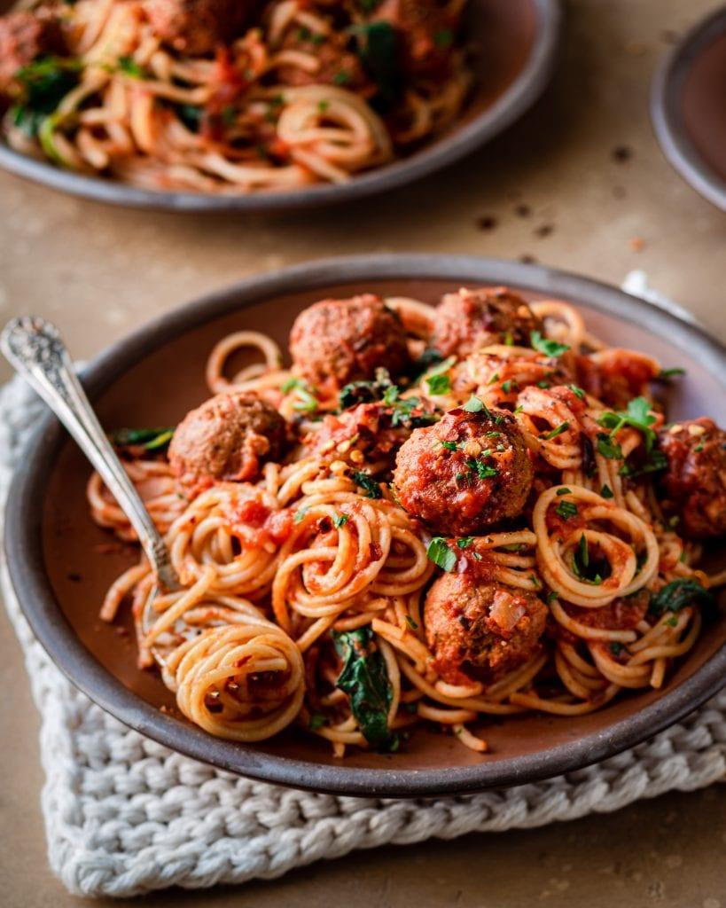 spaghetti and vegan meatballs on a plate