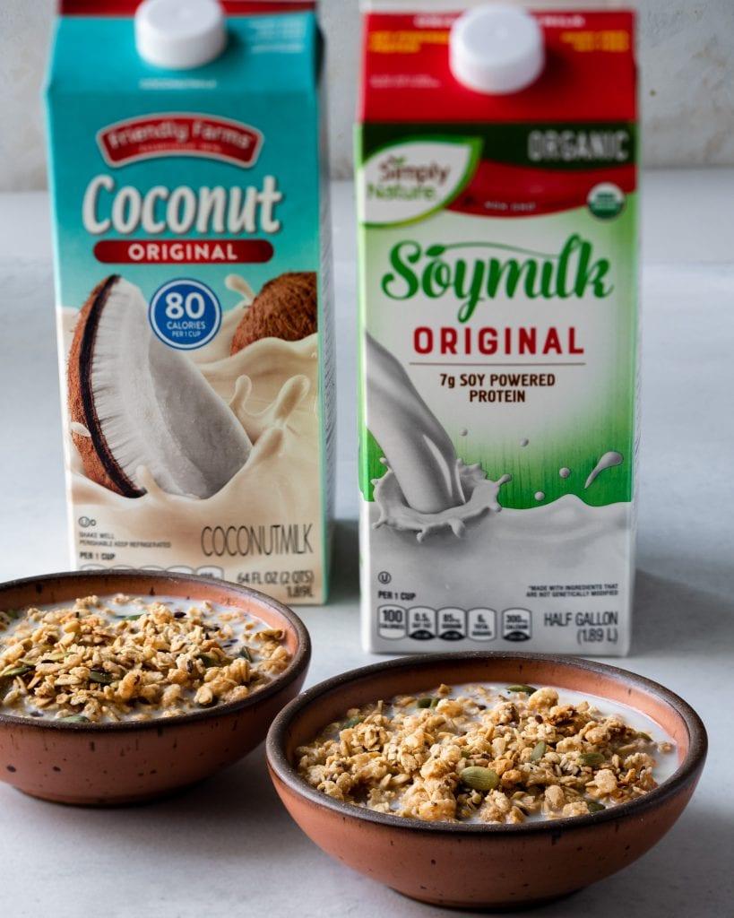 vegan alternative milks with bowls of granola