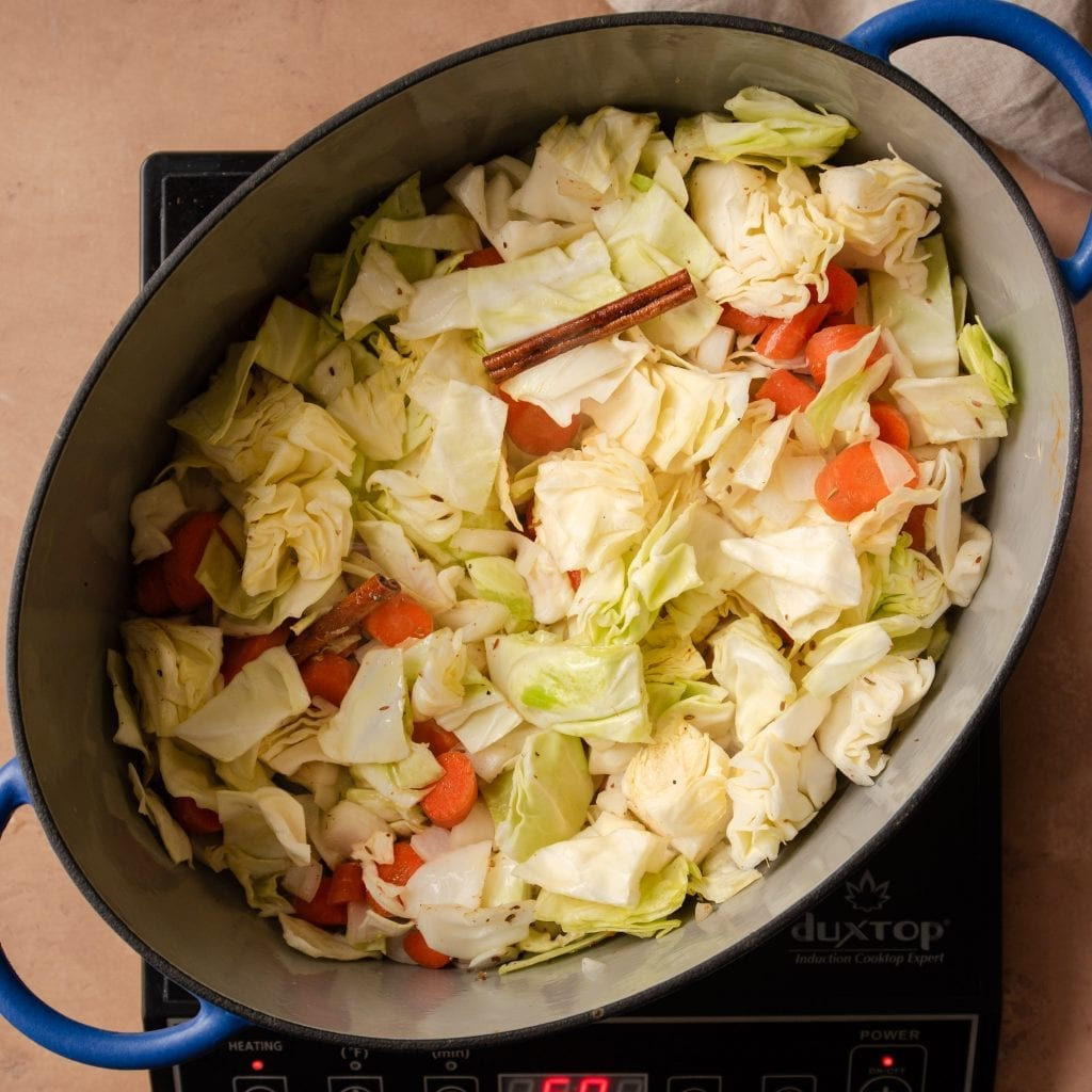 sauteing cabbage and carrots in a dutch oven