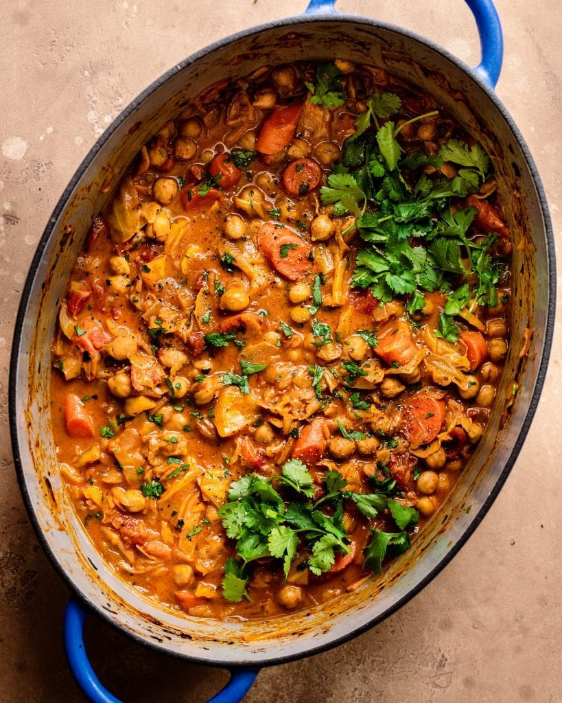 braised indian chickpea stew in dutch oven with cilantro