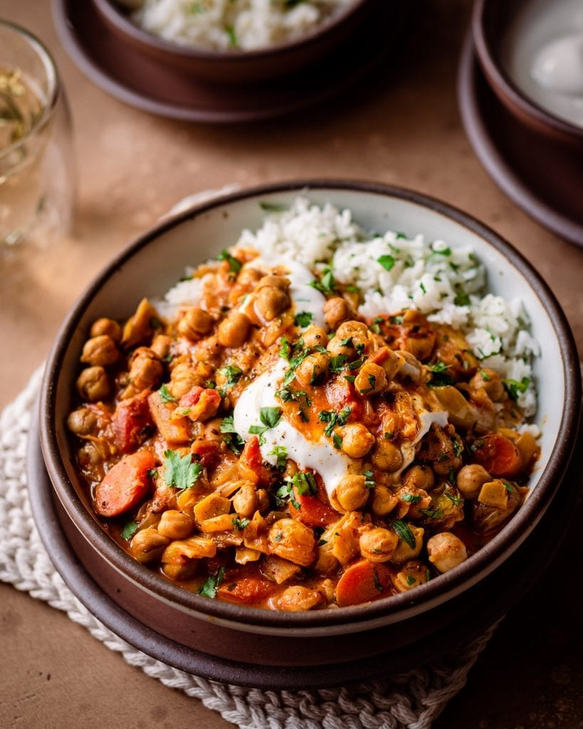 braised indian chickpea stew in bowl with yogurt