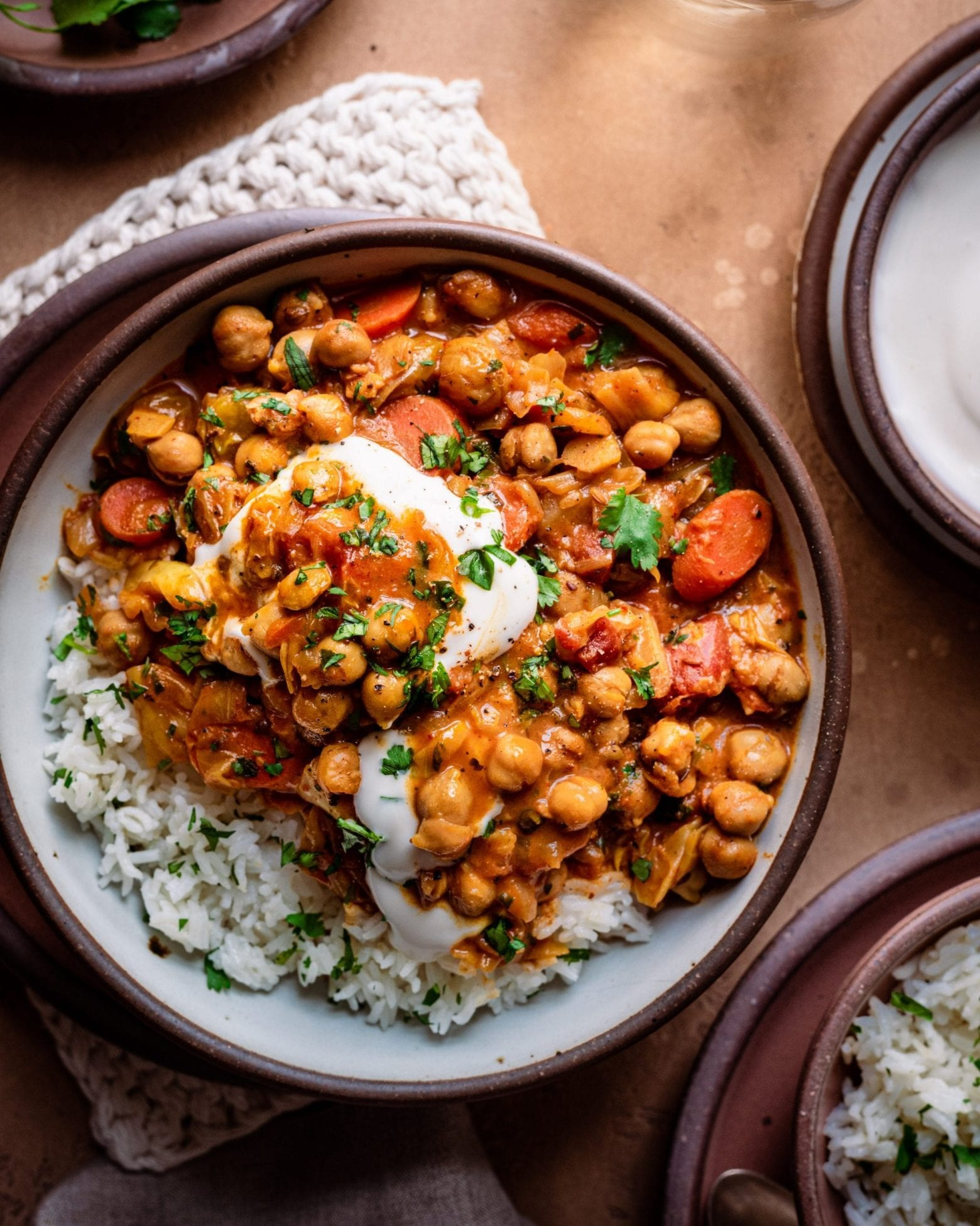 indian chickpea stew in a ceramic bowl served with rice