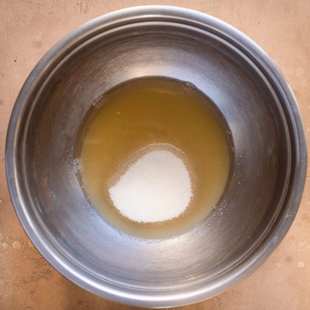 mixing bowl of aquafaba and sugar