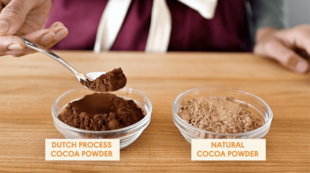 two bowls of cocoa powder on cutting board