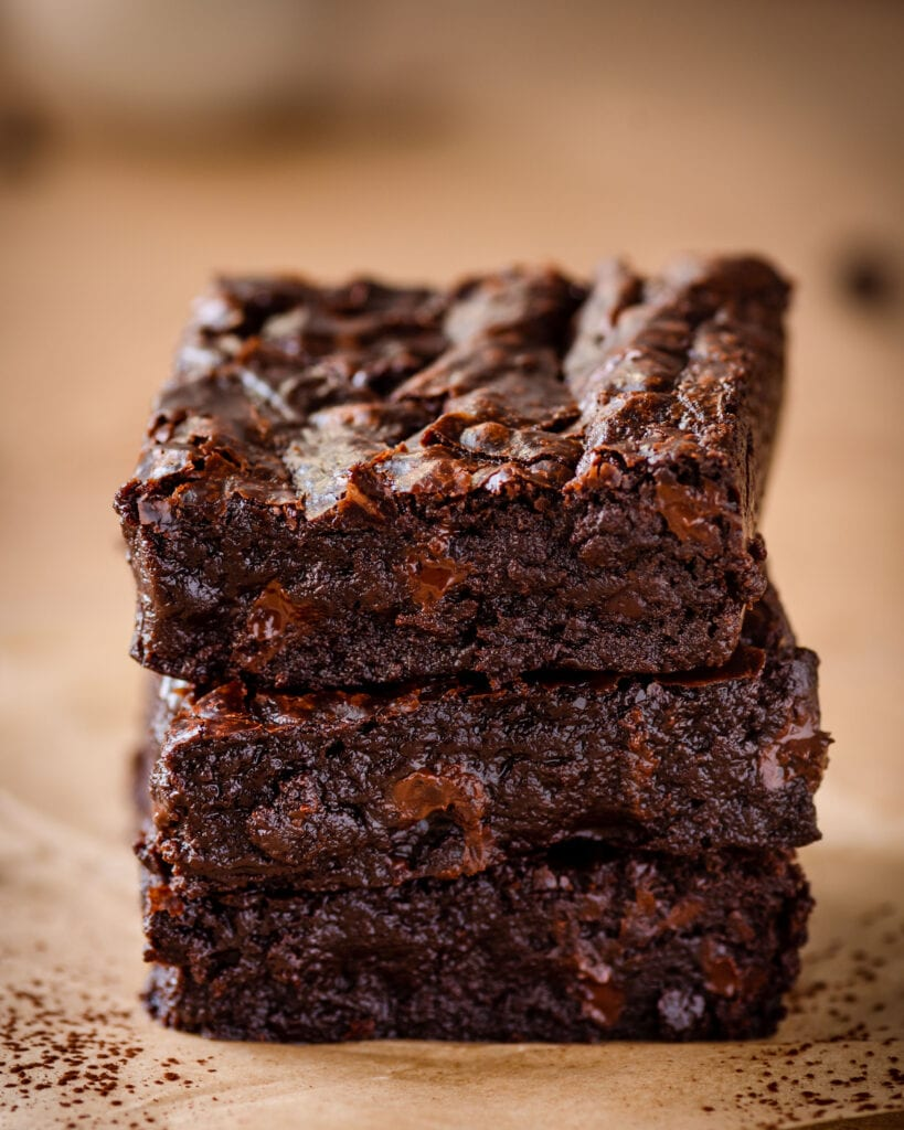 a stack of the best fudgy vegan brownies