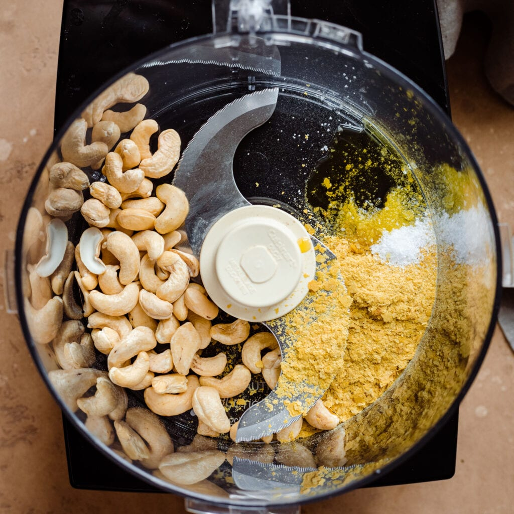 cashews and nutritional yeast in food processor for cashew parmesan