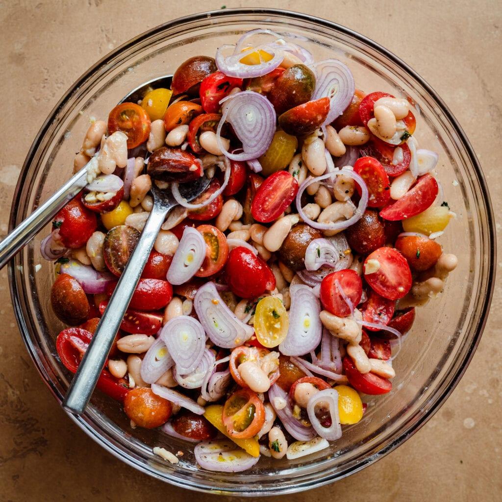 cherry tomato white bean shallot salad in bowl