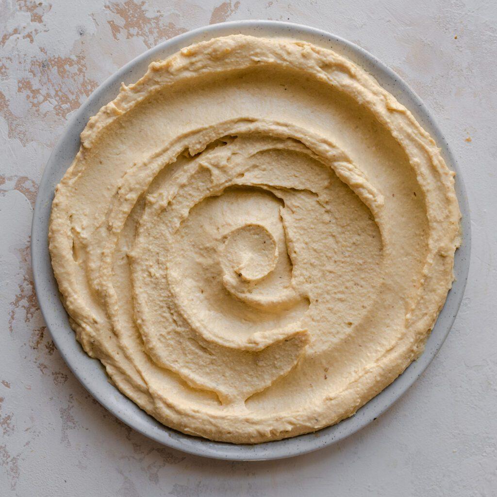 plate of swirled creamy hummus