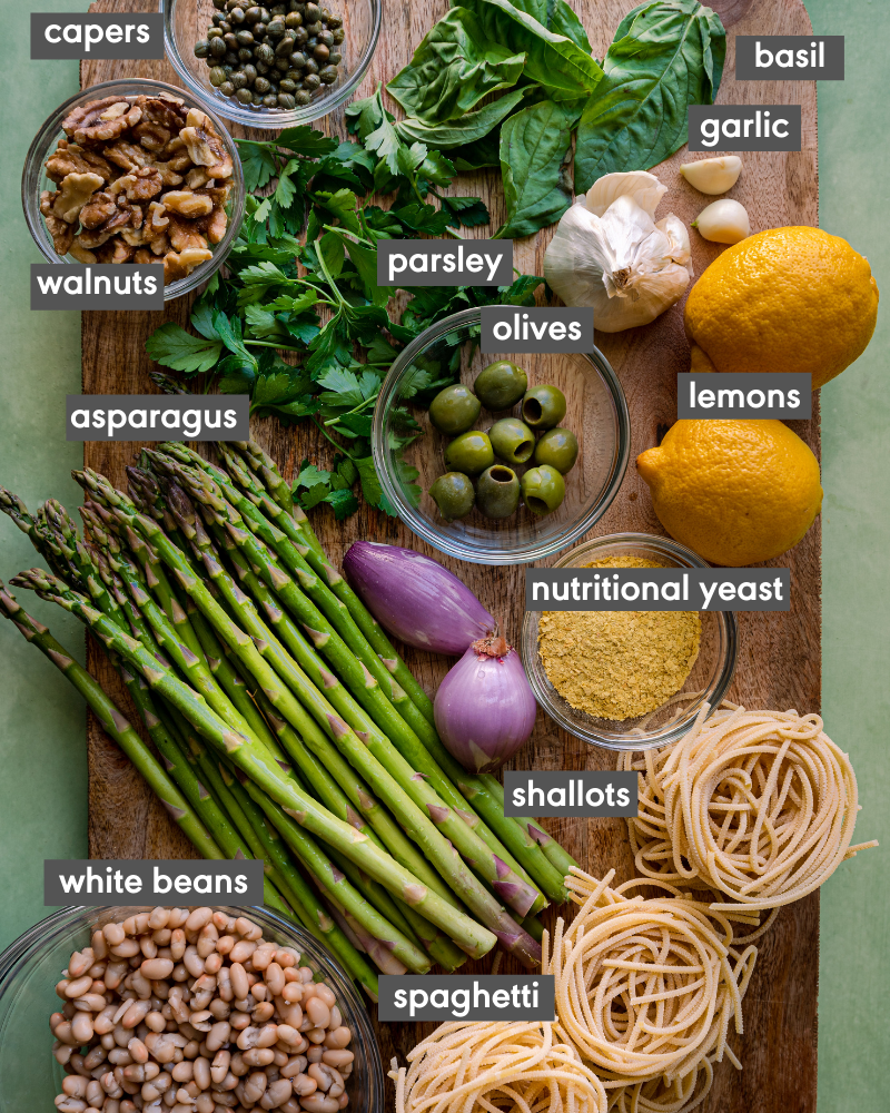 ingredients for lemon asparagus pasta on cutting board with ingredient names
