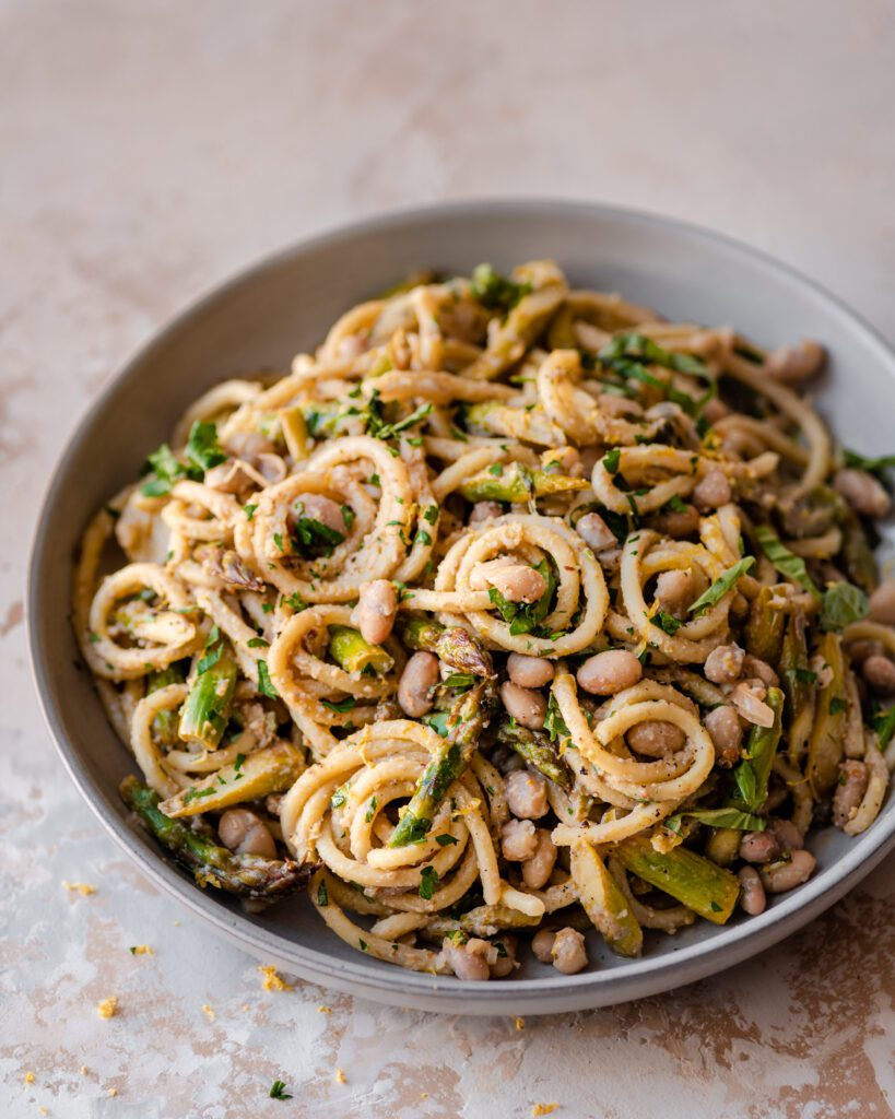 bowl of twirled lemon asparagus pasta