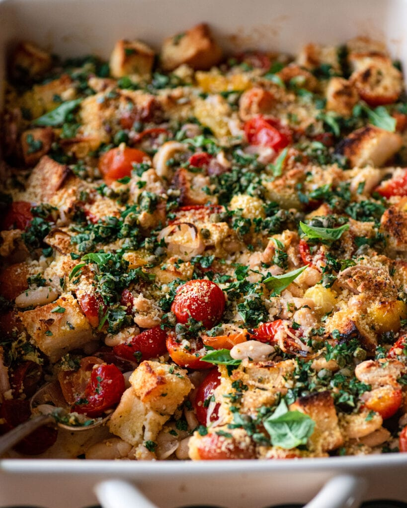 closeup of tomato and white bean casserole with fresh basil