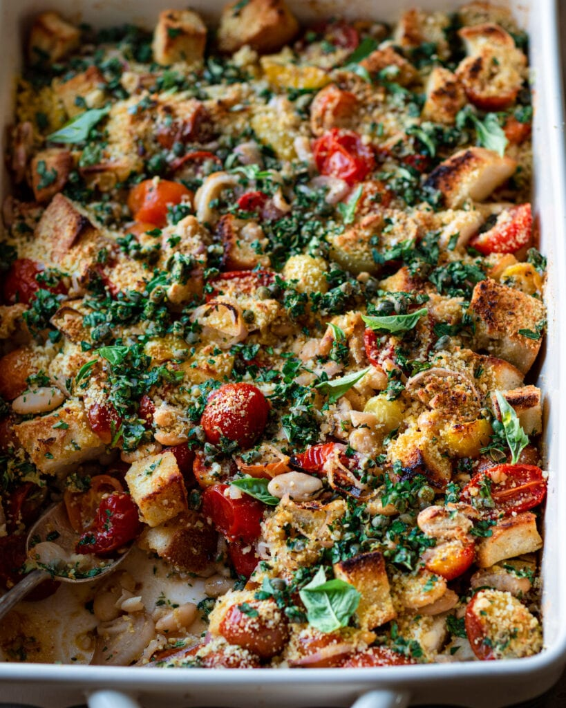 closeup tomato and white bean casserole with fresh herbs