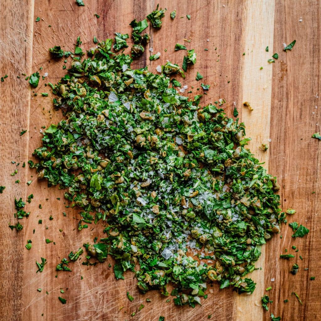 parsley basil caper gremolata on cutting board