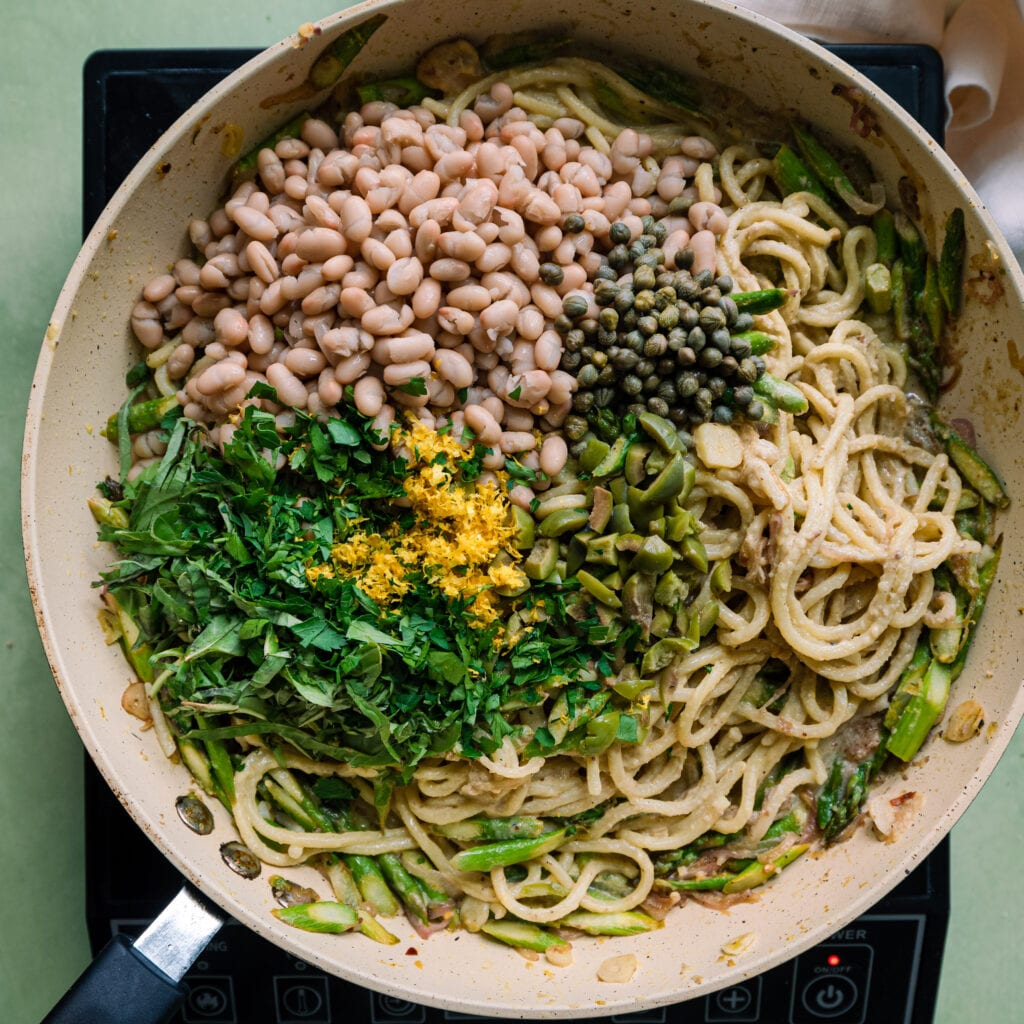 spaghetti al limone with fresh herbs, lemon zest, capers, and olives