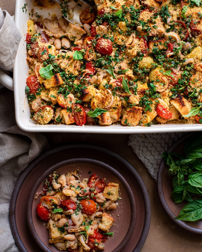 tomato and white bean casserole with serving on a ceramic plate