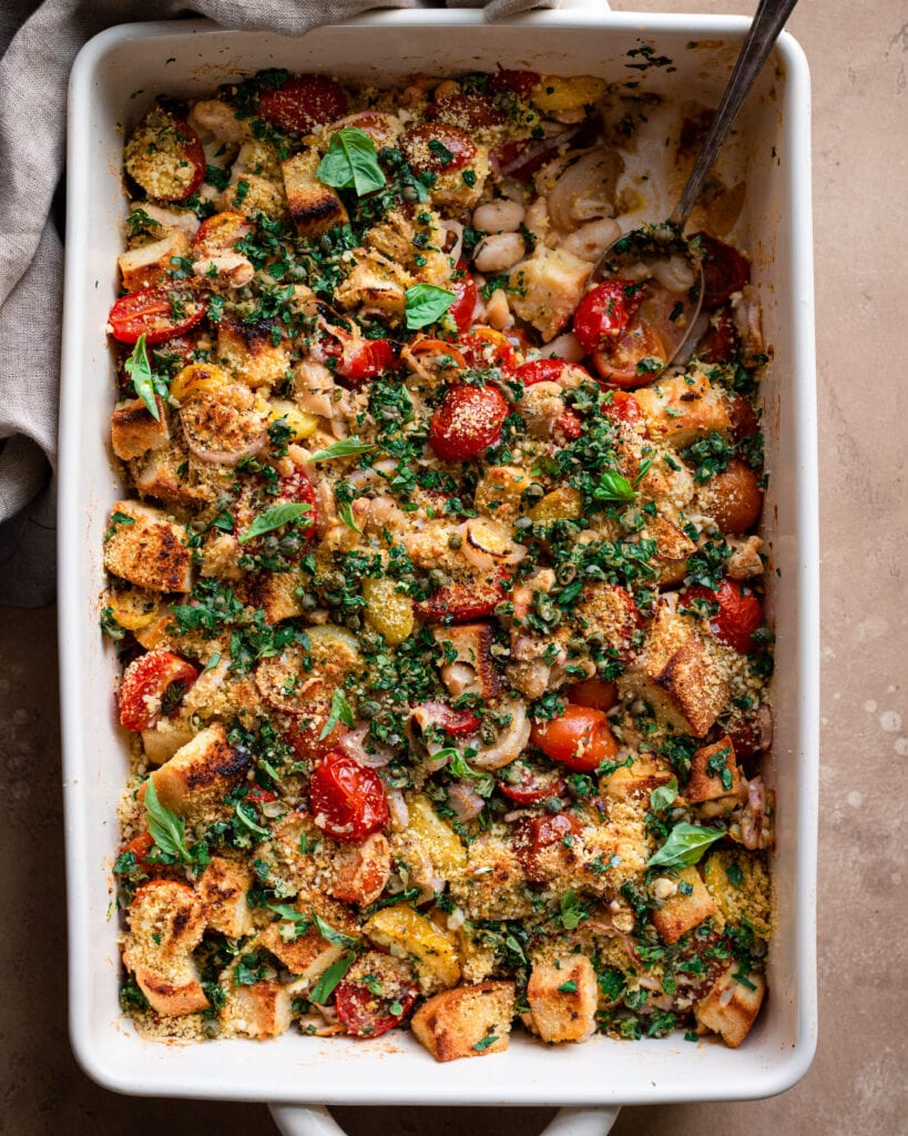 tomato and white bean casserole with spoon dug in