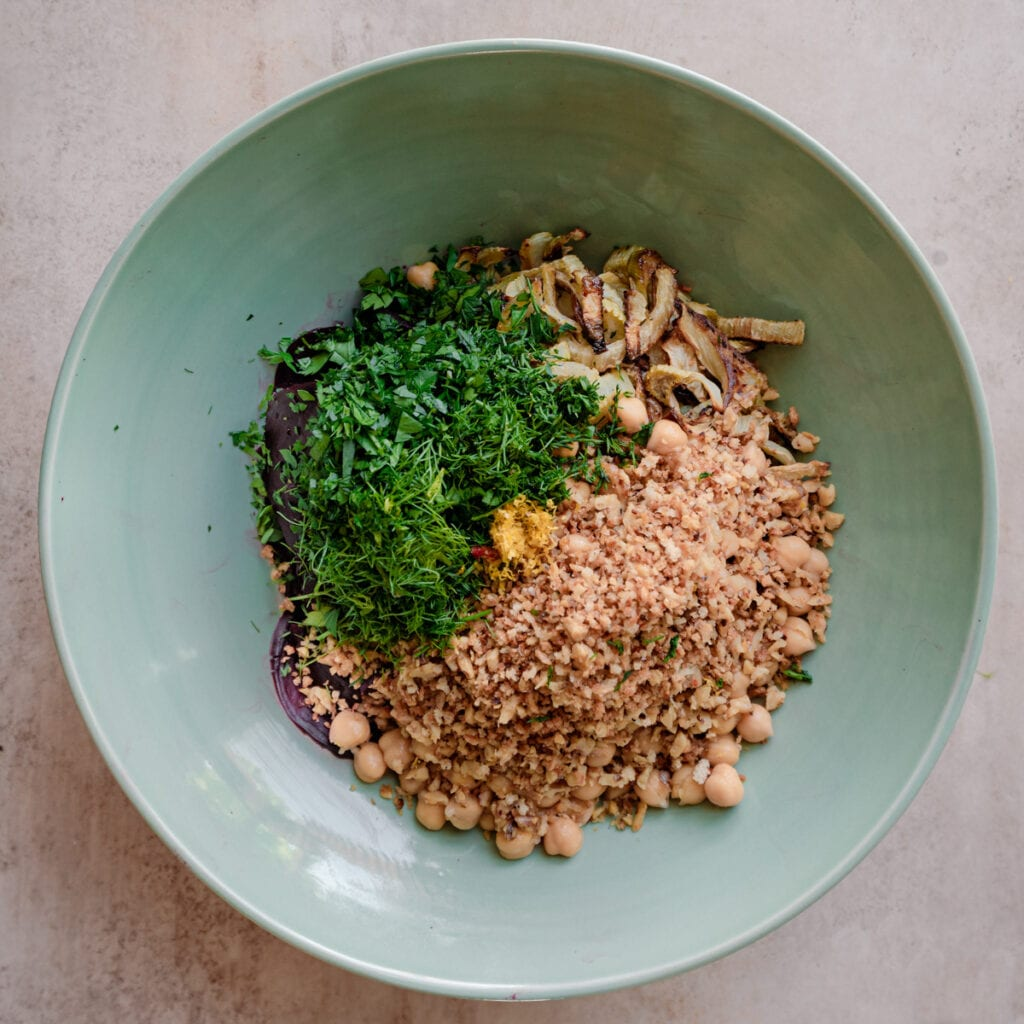 chopped herbs and walnut bread crumbs in bowl with fennel