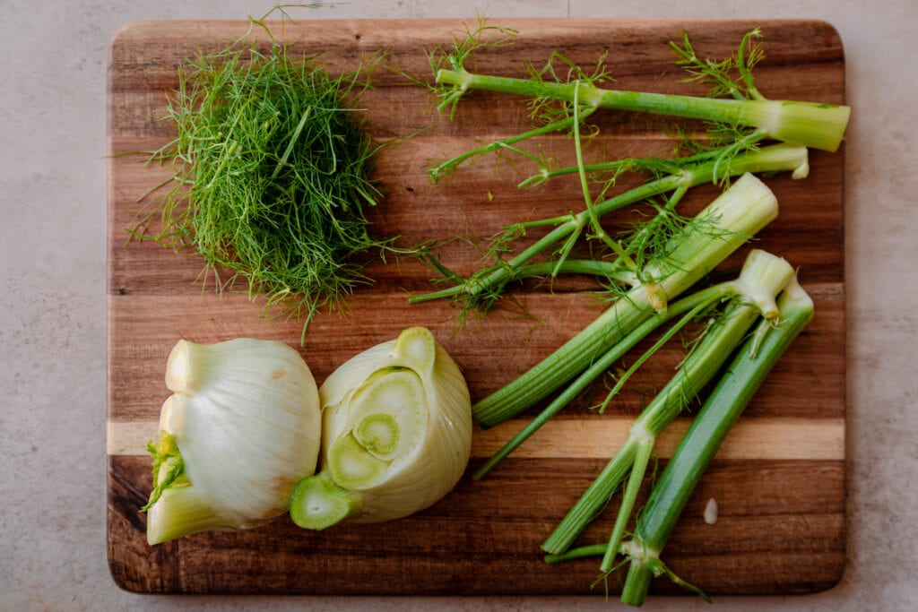 sliced fennel bulbs with fennel stalks and fennel fronds