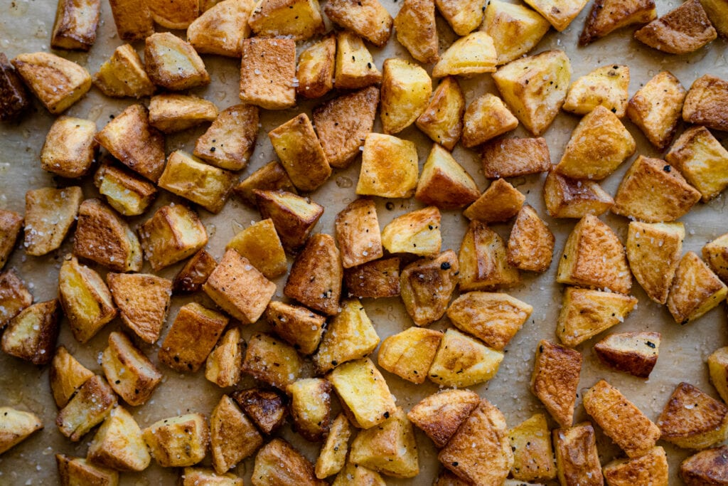 crispy golden roasted potatoes on baking sheet