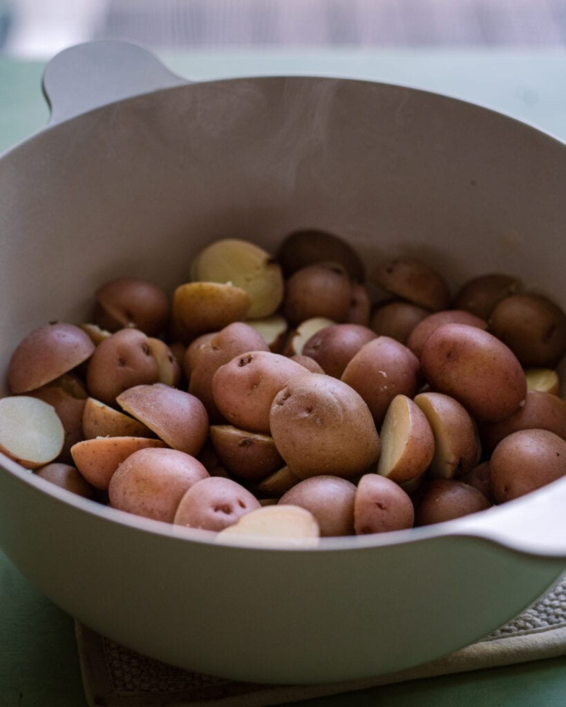 baby red potatoes steaming in a colander