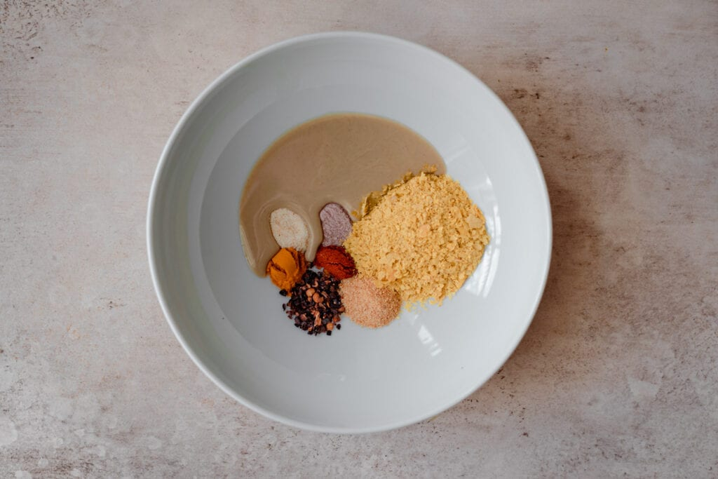 spices, nutritional yeast, and tahini in a bowl