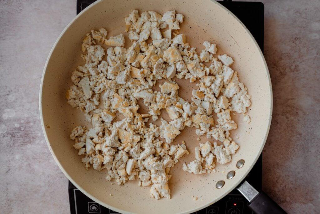 lightly golden tofu scramble in saute pan