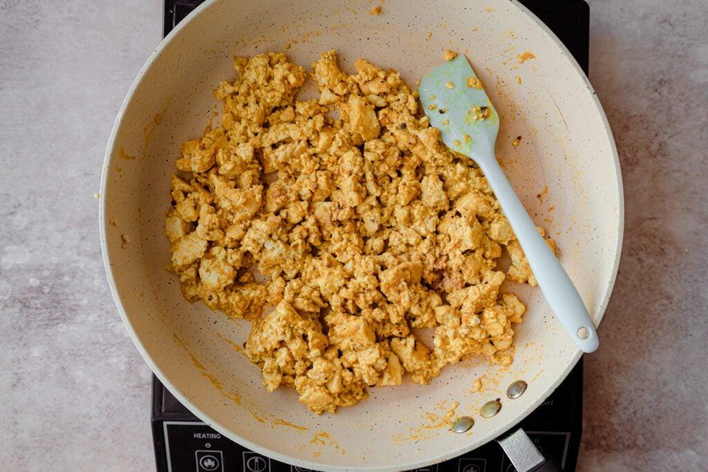 eggy tofu scramble in a frying pan