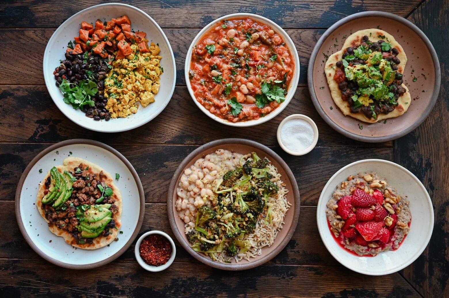 6 vegan meals meals on wooden table