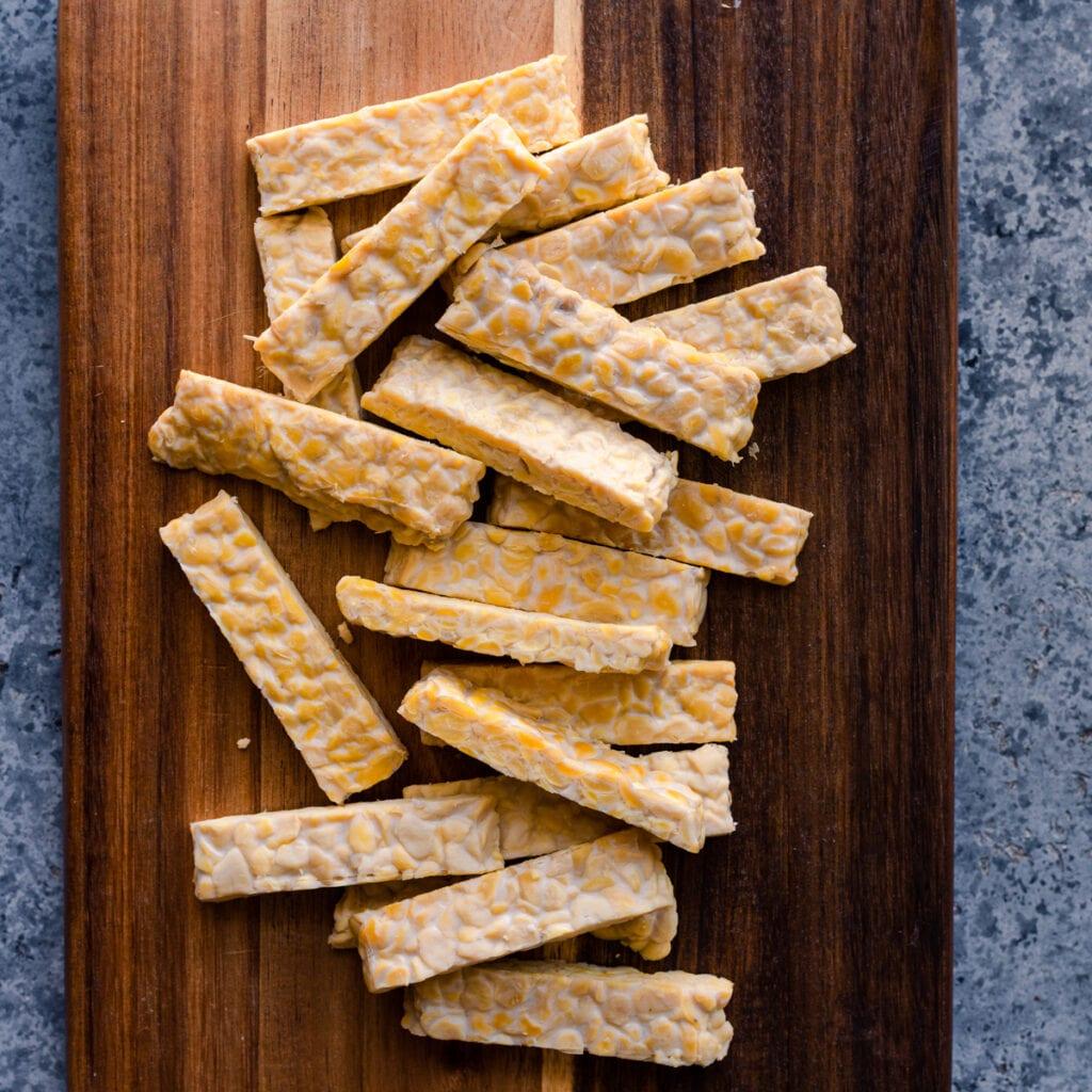 tempeh strips on cutting board