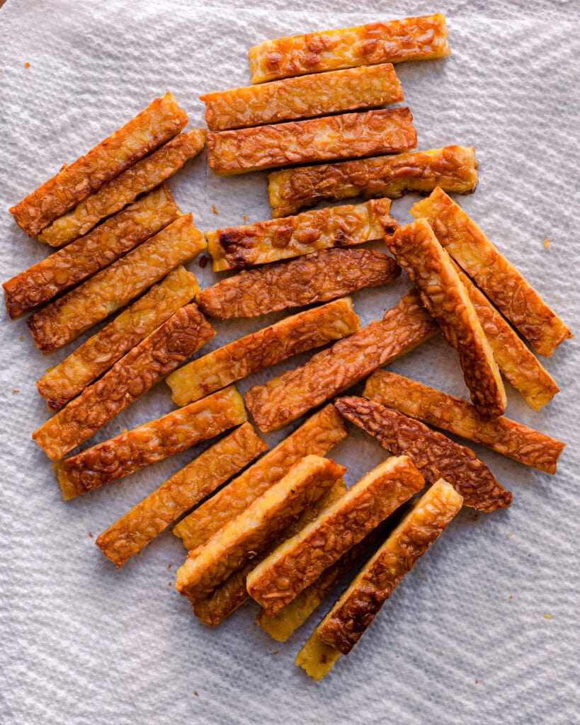 golden brown tempeh on paper towels