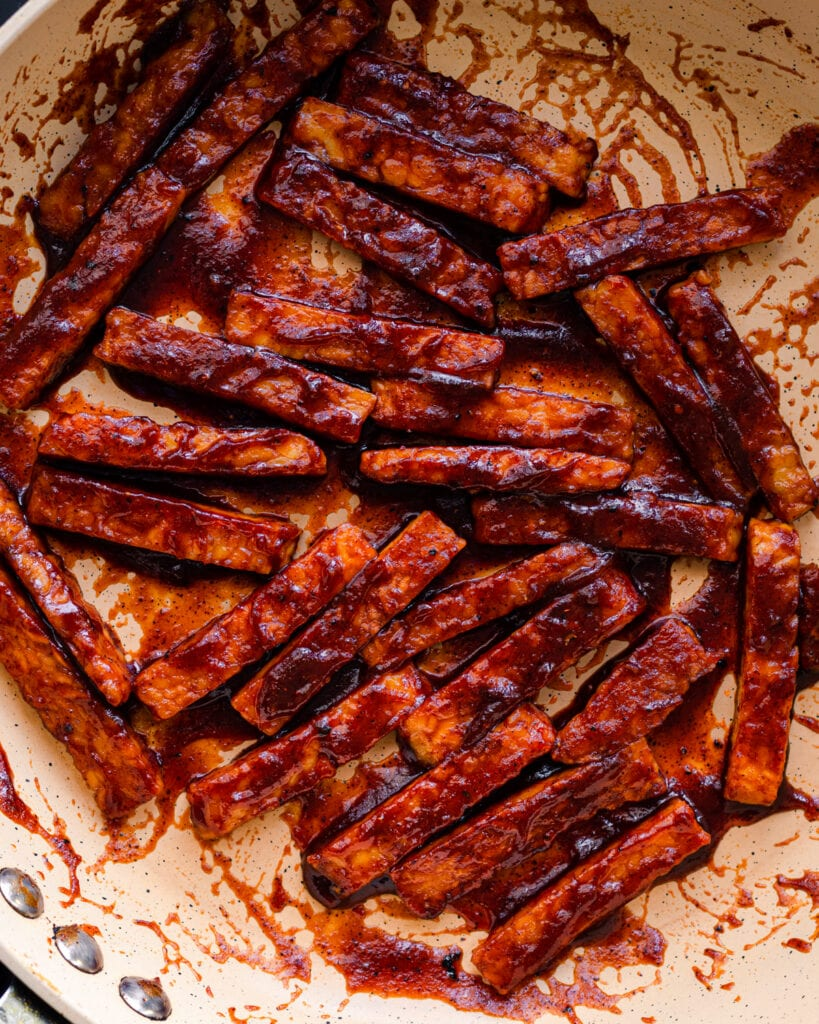 closeup photo of barbecue glazed tempeh in frying pan