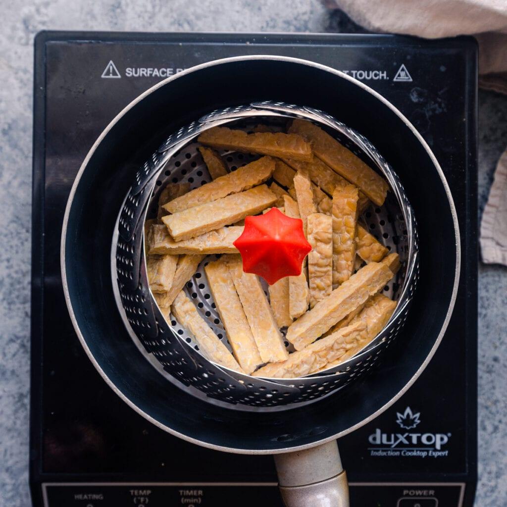 tempeh strips in steamer basket