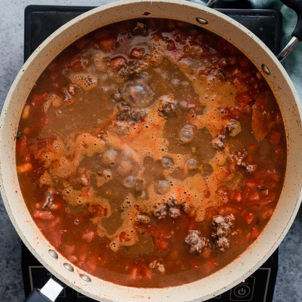 vegan dal makhani simmering in a saute pan