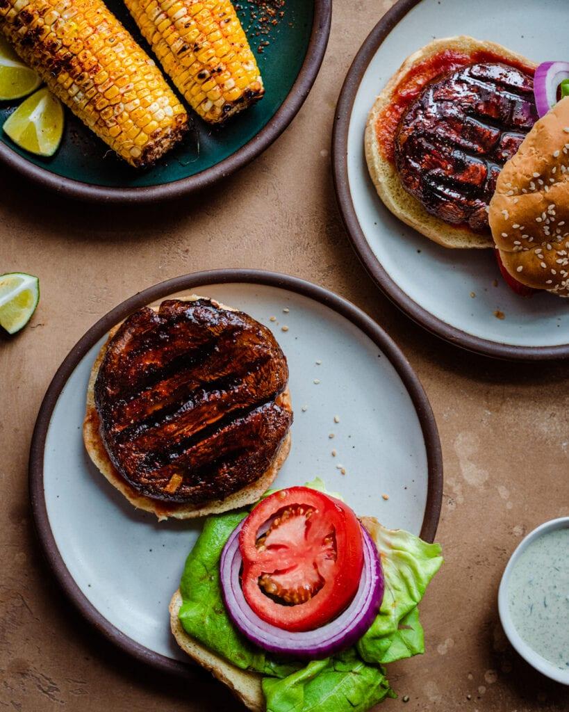 grilled portobello mushroom on burger patty with grilled corn