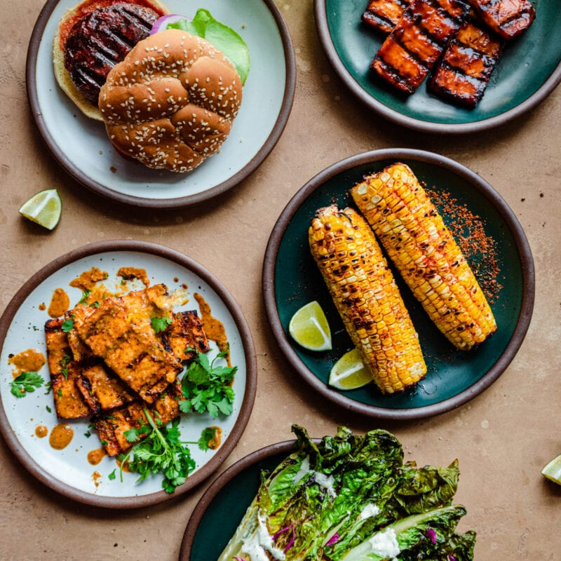 spread of vegan grilled food on a brown surface