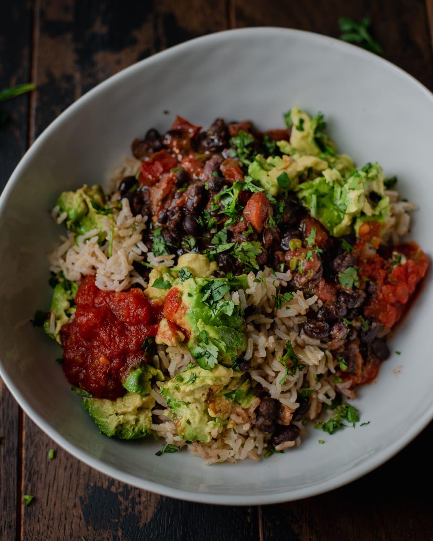 vegan burrito bowl with avocado black beans and salsa
