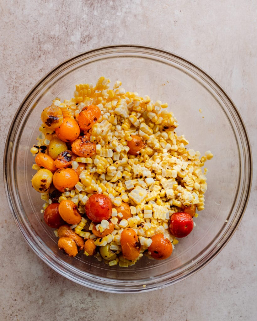 grilled corn and grilled tomatoes in bowl