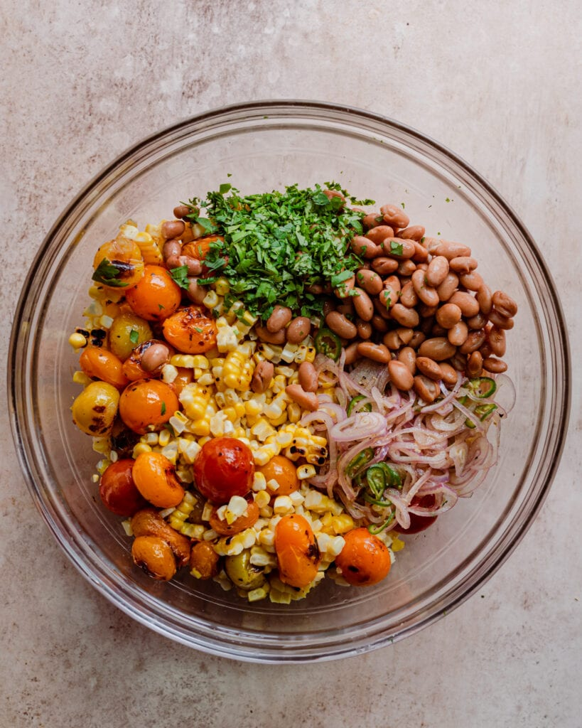 grilled corn salad with cilantro, pinto beans, and pickled shallots