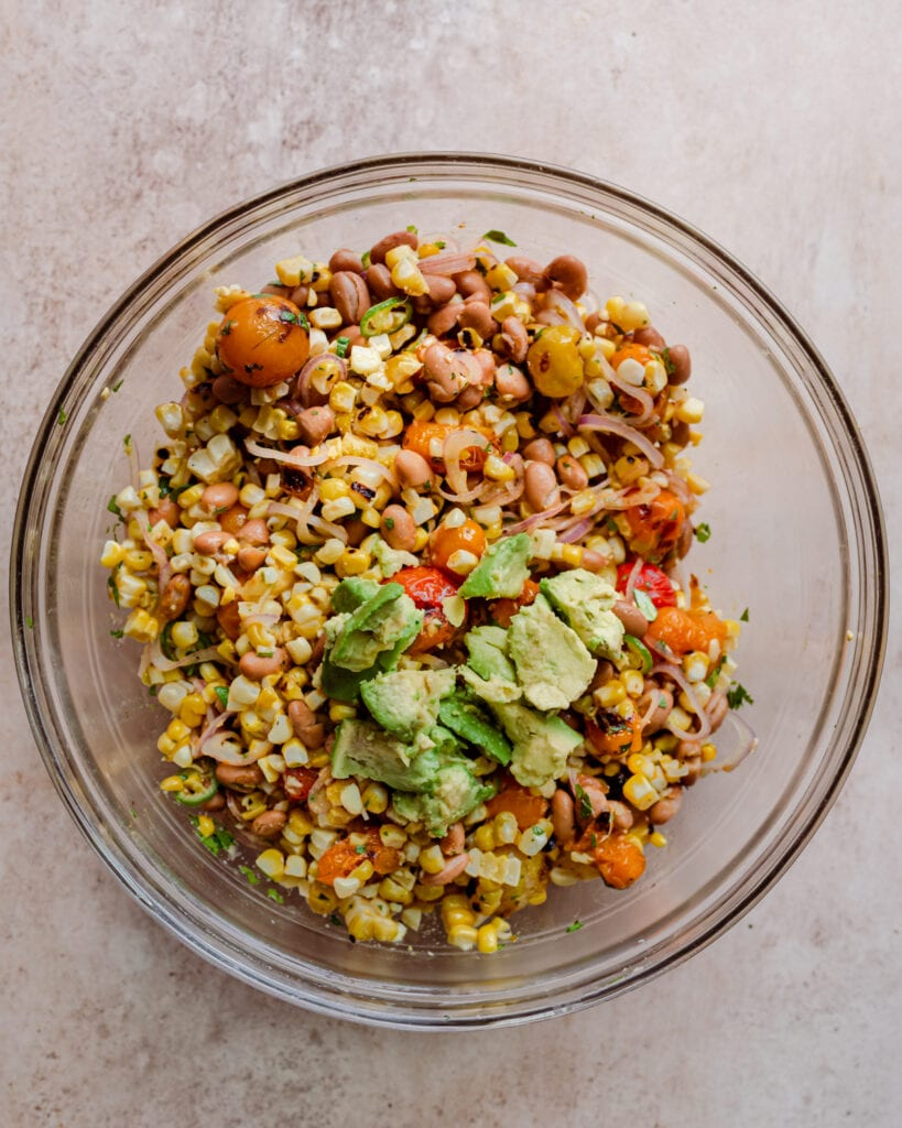 grilled corn salad with avocado, beans, and tomatoes