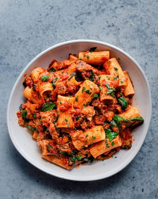 vegan pasta recipe with vegan sausage, marinara sauce, and spinach