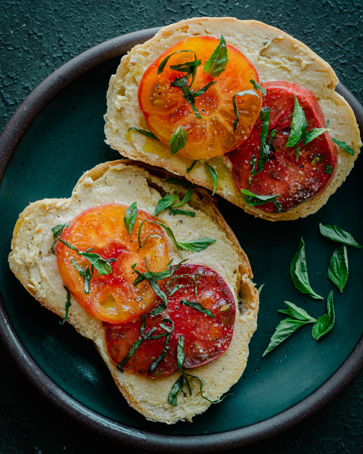 fermented cashew cheese on toast with heirloom tomatoes and basil