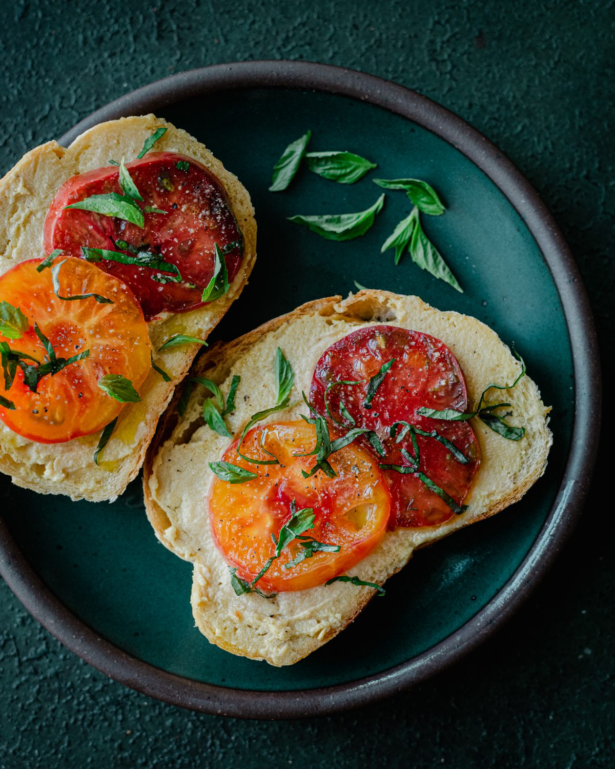 fermented cashew cheese on toast with heirloom tomatoes