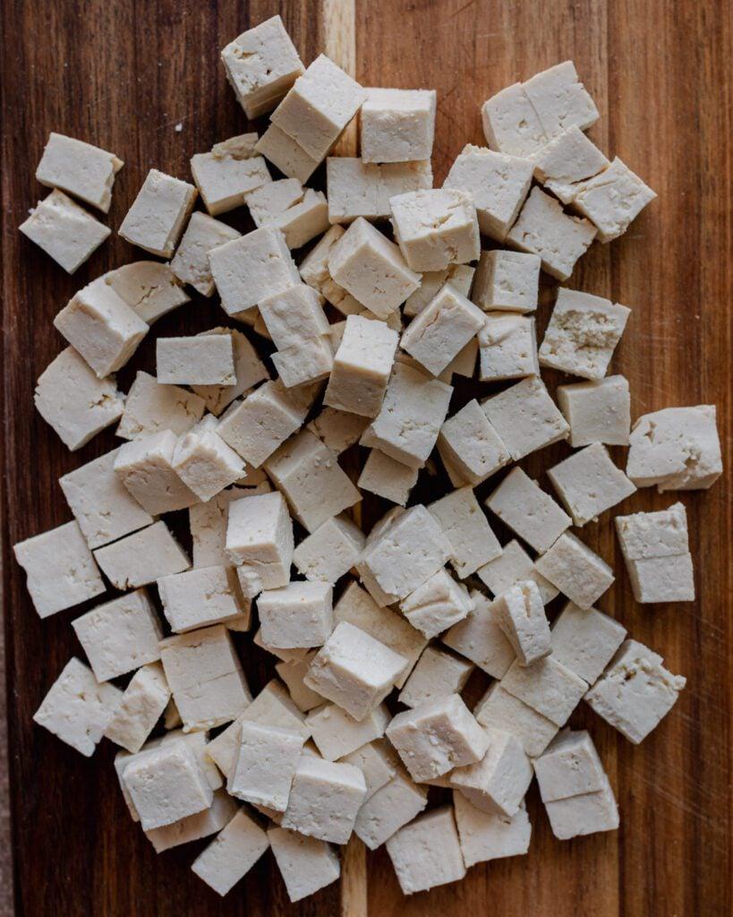 diced tofu cubes on cutting board