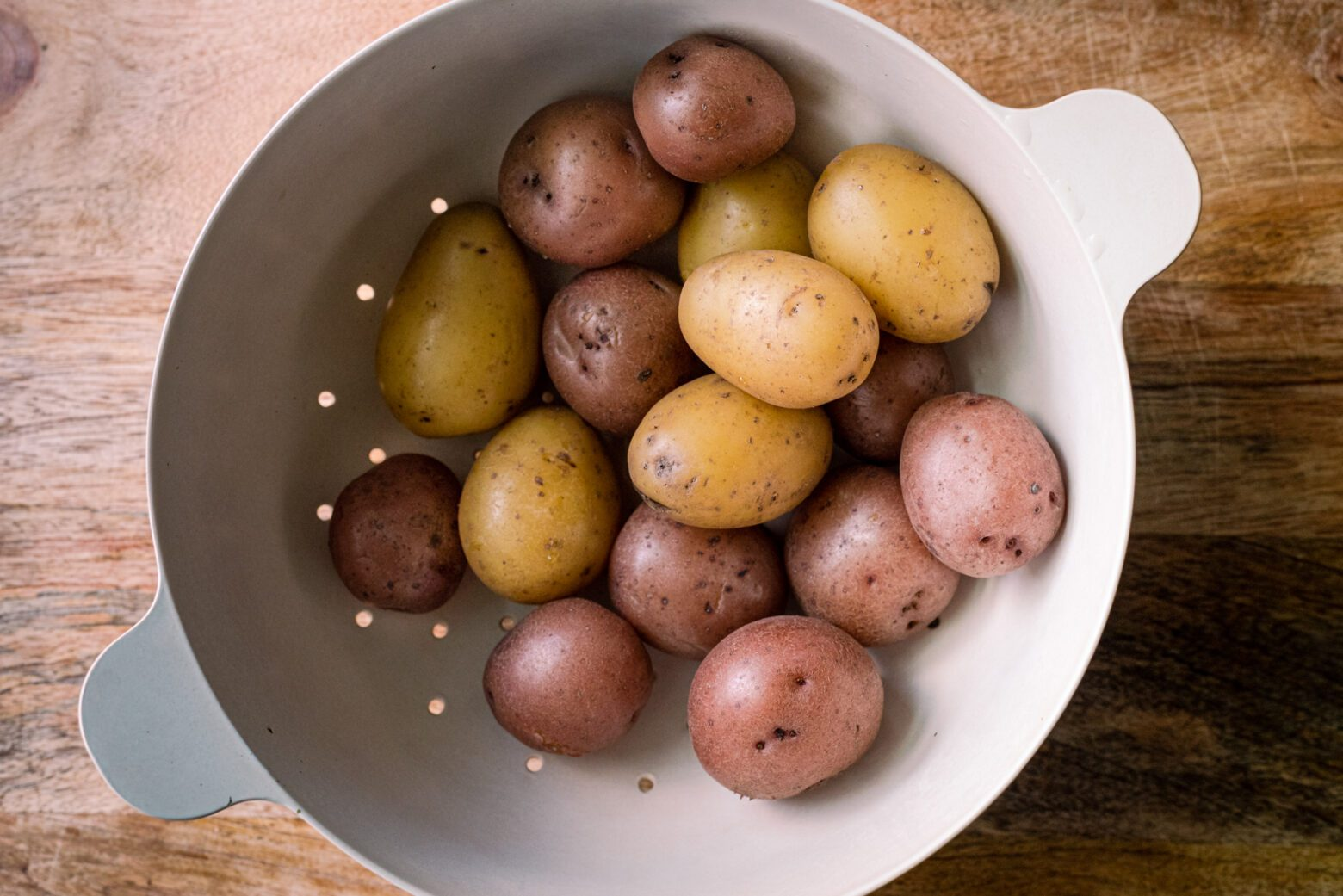 baby potatoes boiled and drained in a colander