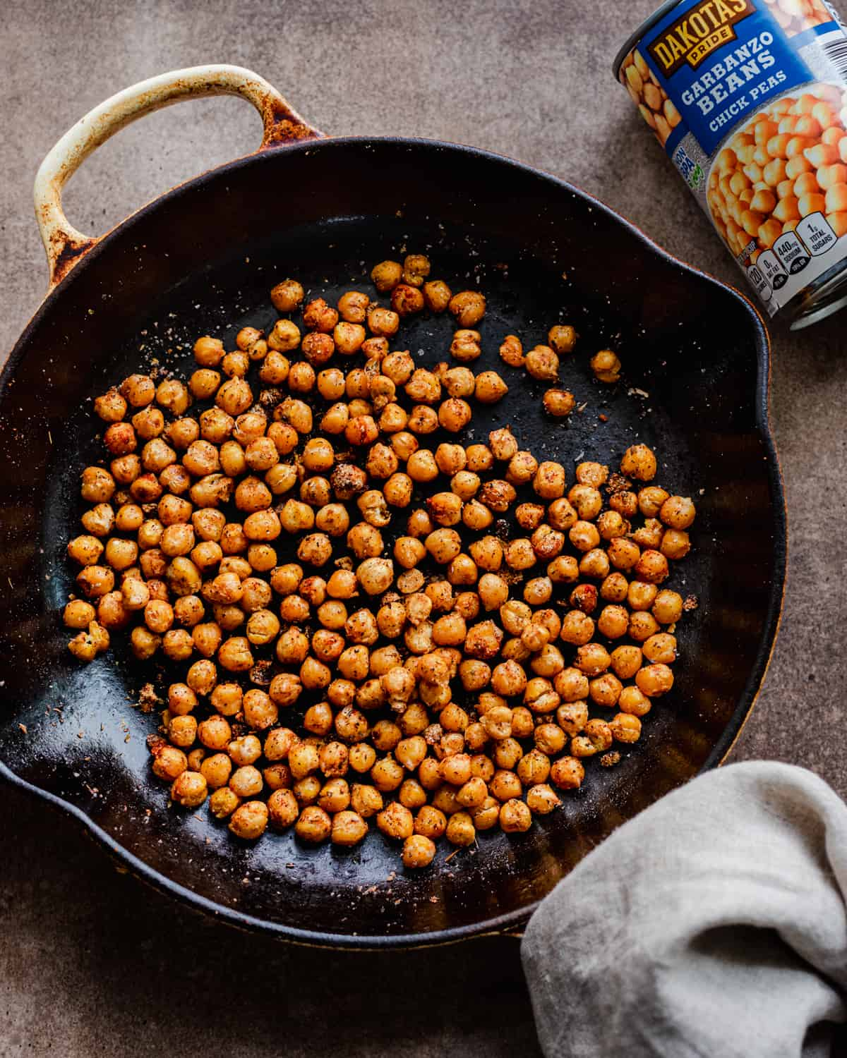 spiced chickpeas in pan with chickpea pan on the side