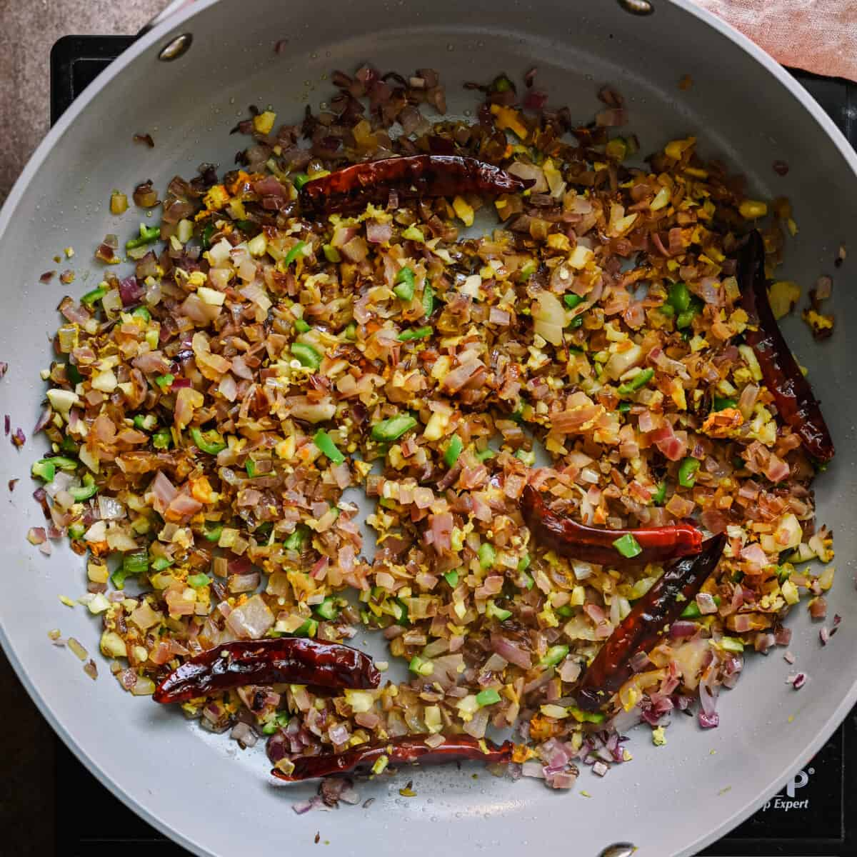 sauteed aromatics in a saute pan for indian cooking
