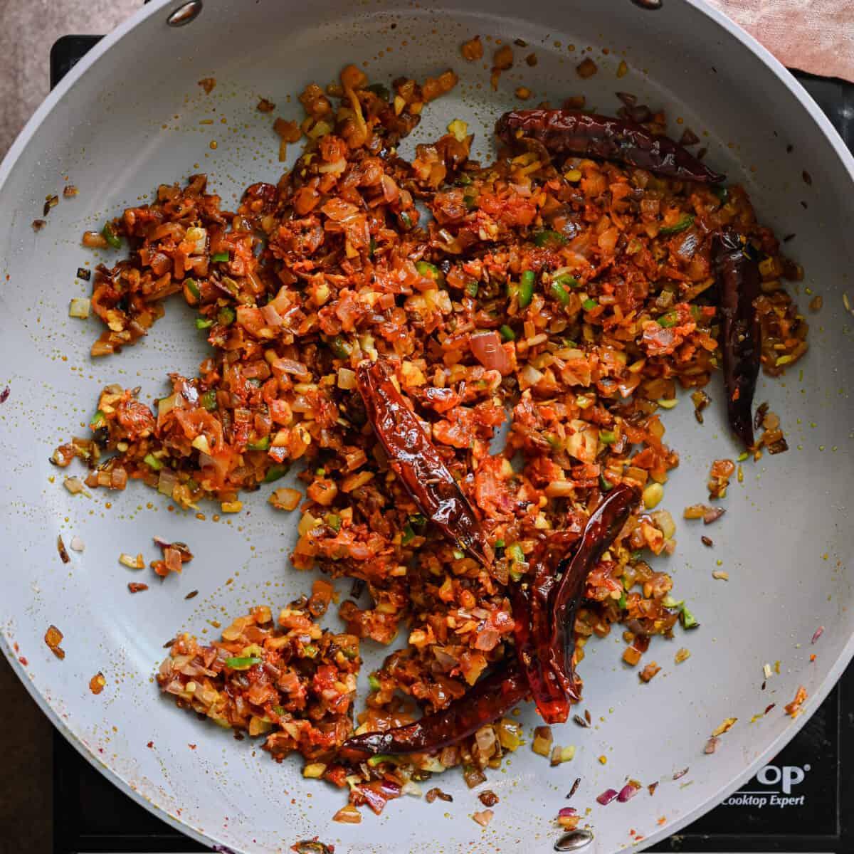 tomato paste stirred into aromatics for indian masala