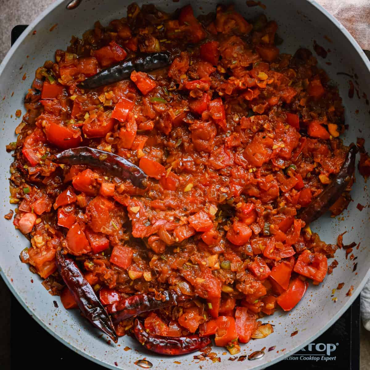 Indian masala cooking in a saute pan