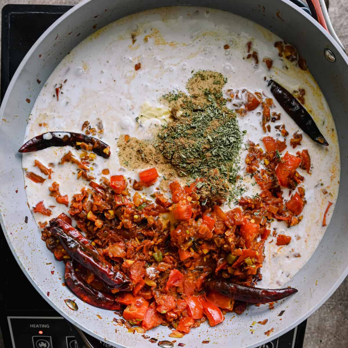 creamy Indian masala gravy in a saucepan with spices