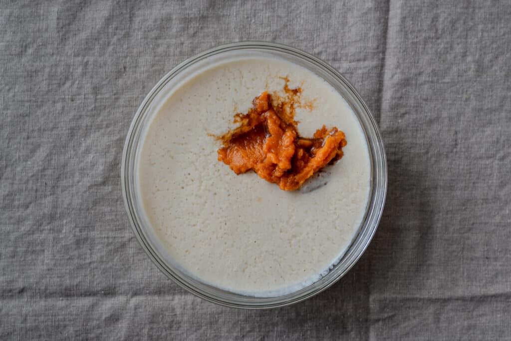pumpkin puree in a bowl of buttermilk